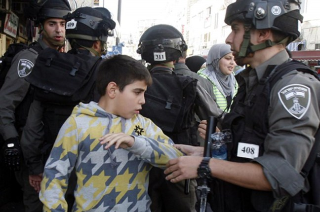 israeli-soldiers-arresting-a-palestinian-boy-child-in-salahaddin-street-for-throwing-stone-at-police-station-e1419623159321