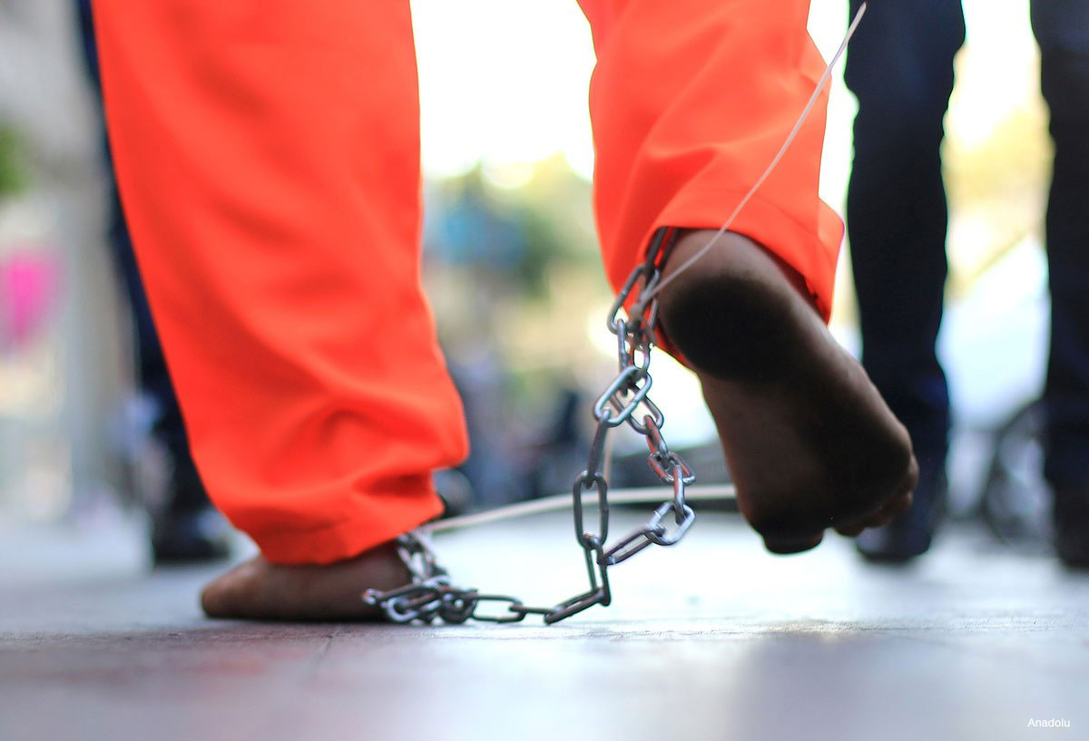 palestinian-man-protestor-detainess-walks-with-chains-around-his-feet
