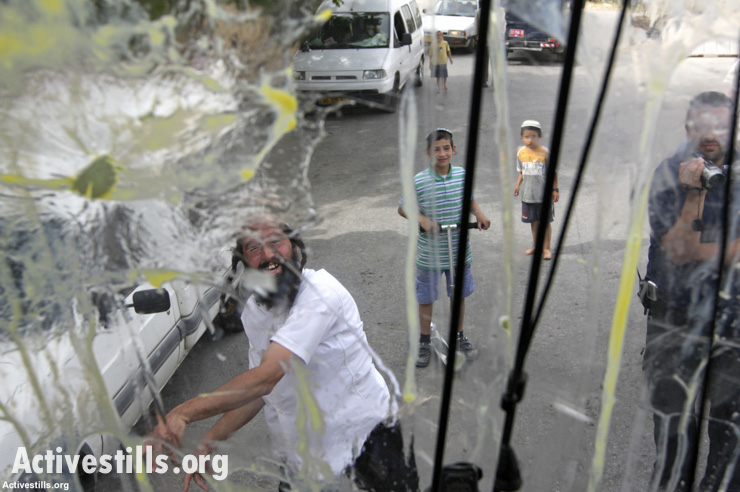 Settlers attack a home in Hebron, April 25, 2008