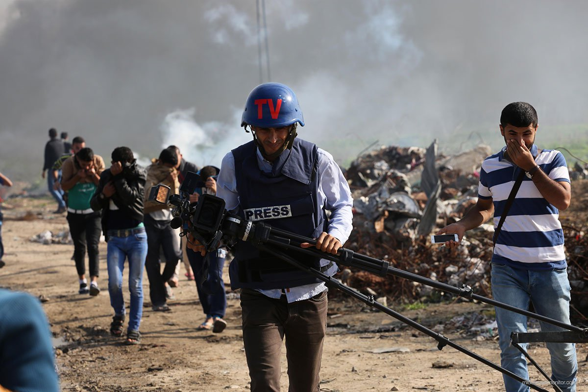 Press-journalist-flees-from-tear-gas-shot-by-Israeli-at-border-in-gaza