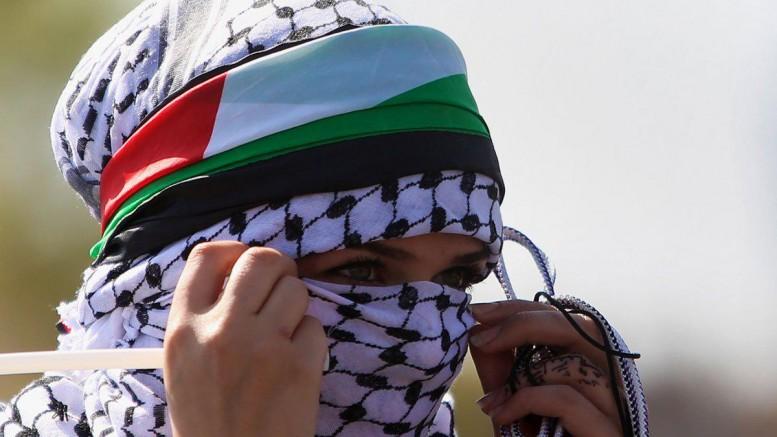 Palestinian-woman-masked-intifada-protestor-777x437