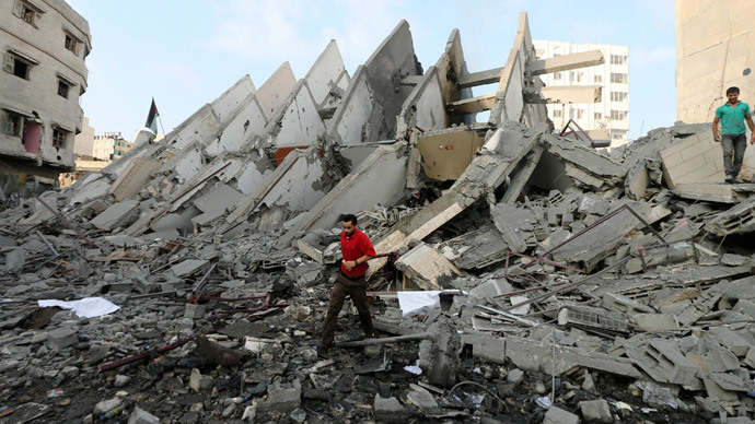 Gaza residential tower building destroyed by war-criminal israeli air strikes, August 25, 2014 rt